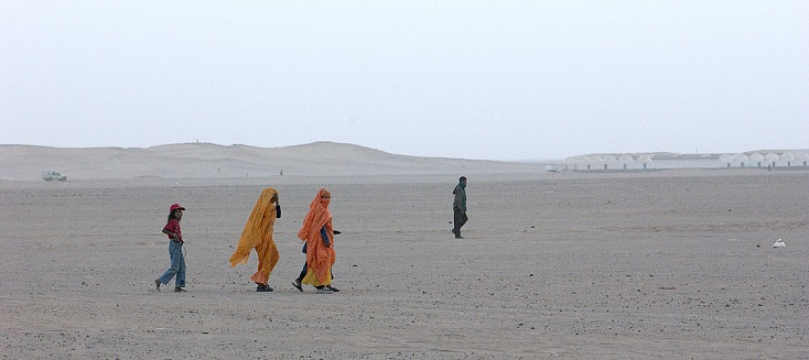 Refugees walk near the Awsard Refugee Camp.