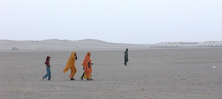 Refugees walk near the Awsard Refugee Camp.
