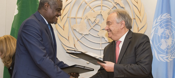 Secretary General António Guterres (right) and Moussa Faki Mahamat, Chairperson of the African Union Commission, shake hands after signing Joint UN-AU Framework for Enhancing Partnerships on Peace and Security.