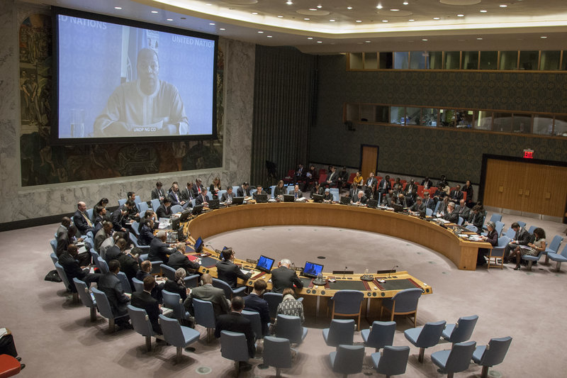A wide view of the Security Council Chamber as Mohammed Ibn Chambas (on screen), Special Representative of the Secretary-General and Head of the UN Office for West Africa (UNOWA), addresses the Council's meeting on threats to international peace and security caused by the extremist group Boko Haram.