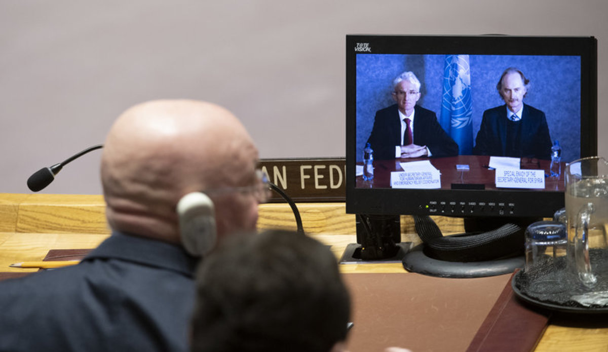 Mark Lowcock (left on screen), Under-Secretary-General for Humanitarian Affairs and Emergency Relief Coordinator, and Geir O. Pederson (right on screen), Special Envoy for Syria, brief the Security Council meeting on the situation in Syria. Listening in the foreground is Vassily Nebenzia, Permanent Representative of the Russian Federation to the United Nations.
